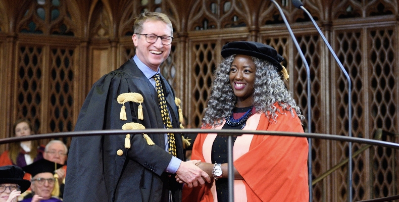Anne-Marie Imafidon receives her honorary DSc from University of Bristol's pro-vice-chancellor Professor John Iredale