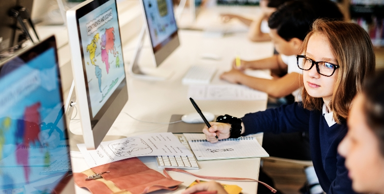 Student-with-computers-stock