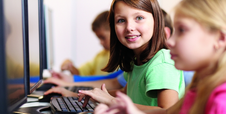 young-girl-computer-digital-learning-stock