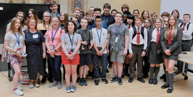Professor Brian Cox with students at the Science Summer School