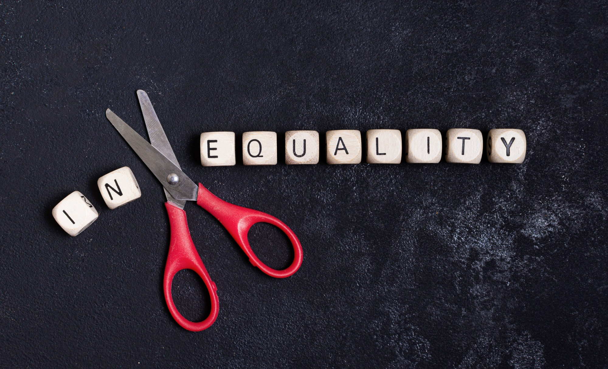equality-inequality-concept-with-scissors