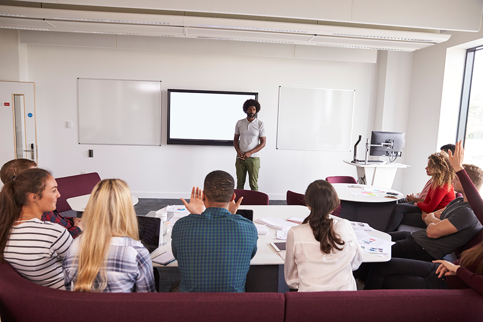 university-students-attending-lecture-on-campus-PFAYTUK